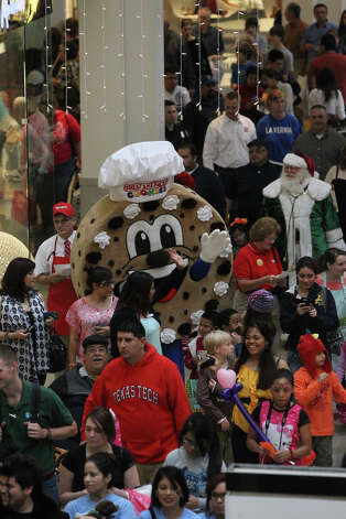 A holiday parade winds through North Star Mall Black Friday November 23, 2012. Photo: John Davenport, San Antonio Express-News / San Antonio Express-News