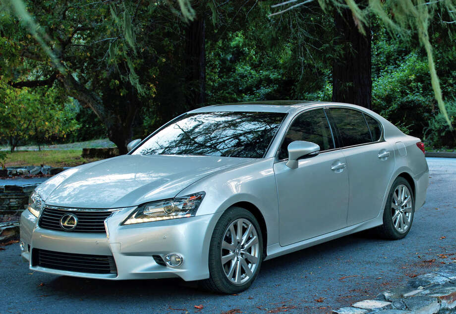"""With the changes for 2013, the Lexus GS sedan offers a comfortable,  sporty, quiet, nimble ride. Lexus also added the unique corporate  """"spindle"""" grille, giving an aggressive look to the otherwise elegant GS. Photo: Toyota Motor Sales U.S.A."""