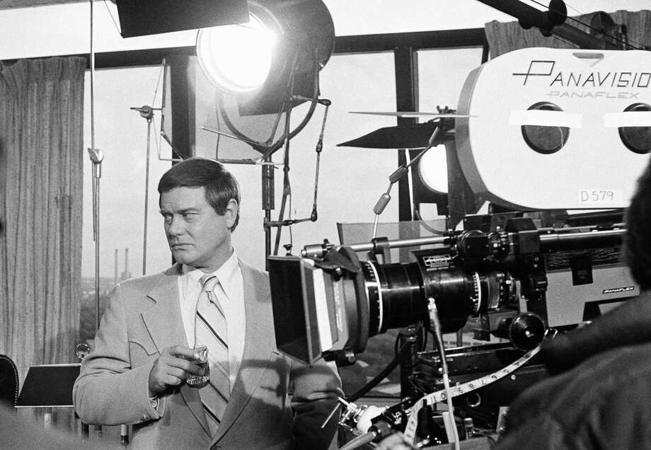 """FILE - This Feb. 2, 1979 file photo shows actor Larry Hagman next to a camera on the set of the television series """"Dallas.""""  Actor Larry Hagman, who for more than a decade played villainous patriarch JR Ewing in the TV soap Dallas, has died at the age of 81, his family said Saturday Nov. 24, 2012. Photo: George Brich"""