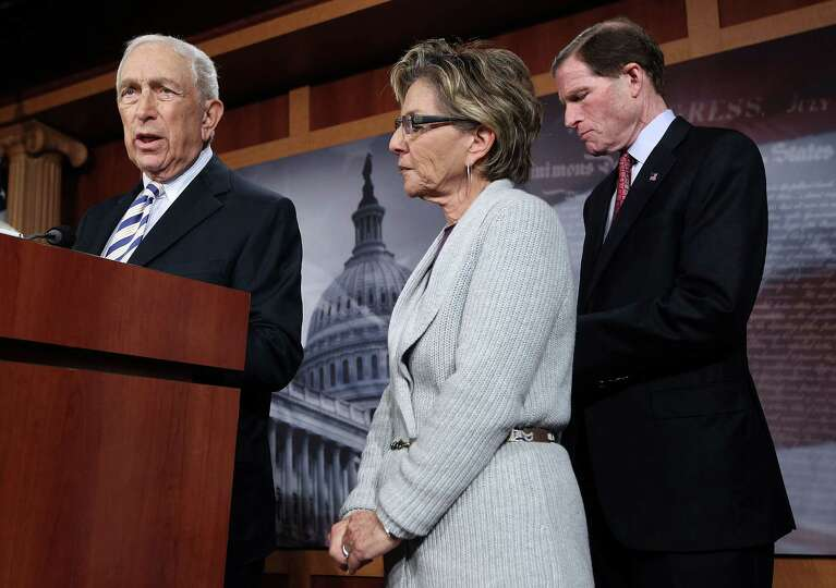 U.S. Sen. Frank Lautenberg (D-NJ) (L) speaks as Sen. Richard Blumenthal (D-CT) (R) and Sen. Barbara