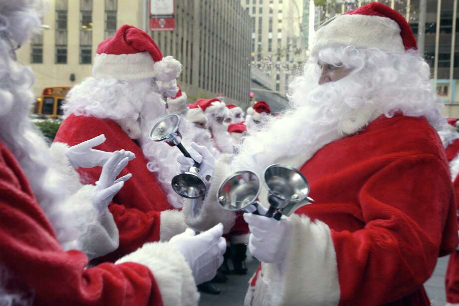 Bells are distributed to Volunteers of America Santas for the 110th annual Sidewalk Santa Parade, in New York,  Friday, Nov. 23, 2012. The donations they raise are used for a holiday food voucher program for needy residents. Photo: Richard Drew, AP / AP
