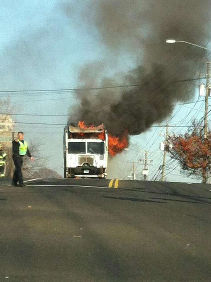 A garbage truck caught fire Friday on Connecticut Avenue. Photo: Contributed Photo