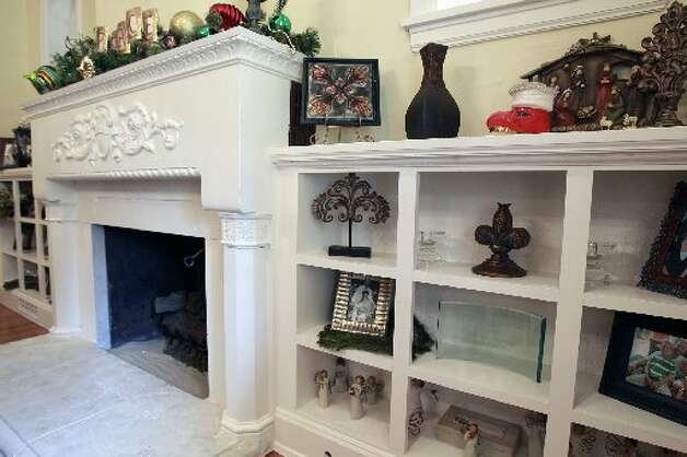 This fireplace is original to the 1937 Spanish-style house. the Mitchells expanded the house to more than 4, 4000 square feet.