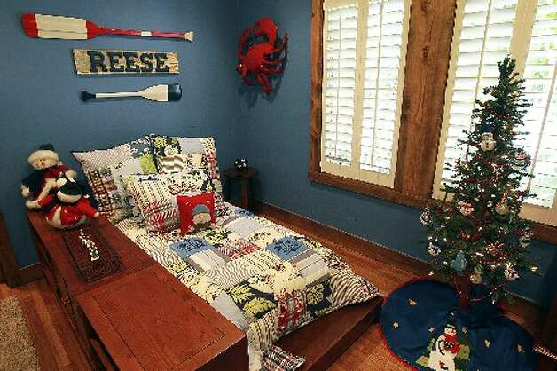 A boy's bedroom reflects his interests. Bedrooms were added to the original 1,600-square-foot home.