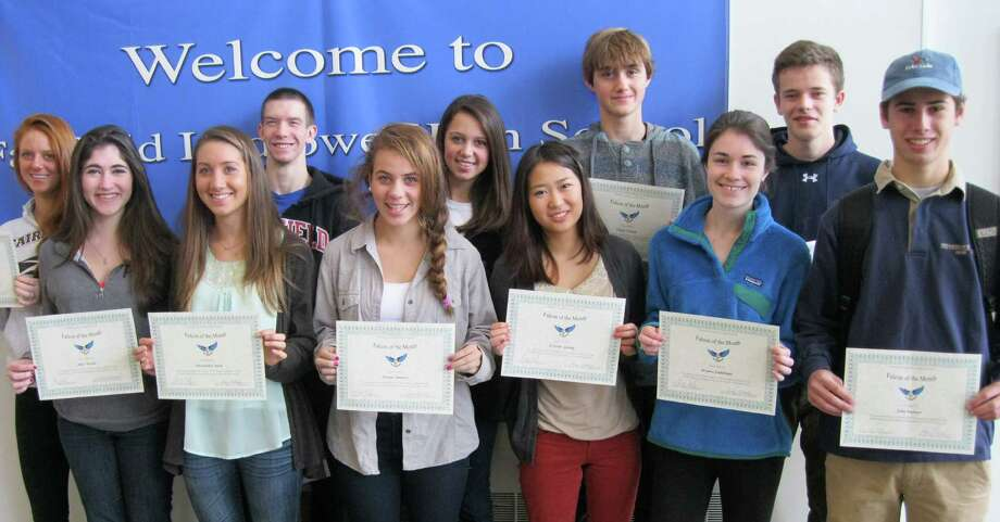 Fairfield Ludlowe High School's Falcons of the Month for October gathered for a group portrait. Ludlowe recognizes students each month for  reflecting an element of the school's mission statement; for October, it was fellowship. From left are: Jenifer Repaci, Alice Rocha, Alexandra Nick, Brayden Fuscaldo, Paula Camara, Sarah Jennings, Kristen Young, Chase OíSuch, Briana Stuhlman, Michael Perlman and John Palmer.  Honored but not present for the photo were Stephanie Gabriel, Morgan Moore and  Gavin Georgiadis Photo: Contributed Photo / Fairfield Citizen contributed