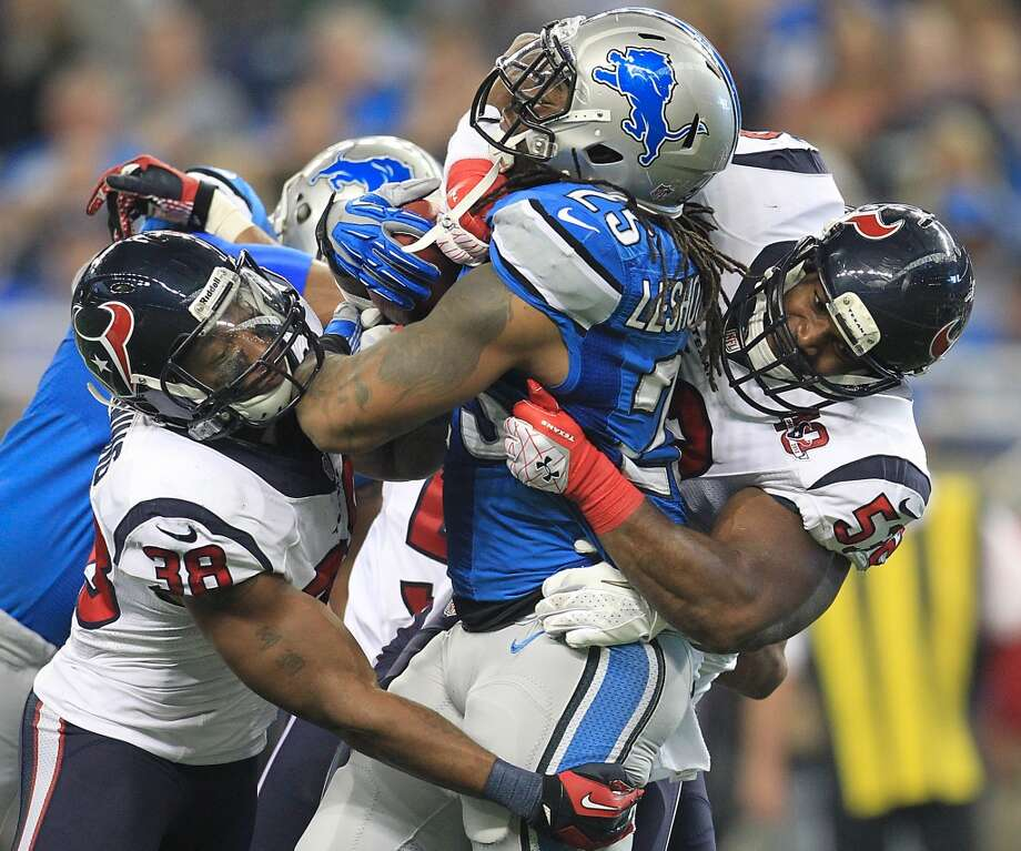 Lions running back Mikel Leshoure (25) is tackled by Texans free safety Danieal Manning (38) and inside linebacker Tim Dobbins (52) during the first quarter. (Karen Warren / Houston Chronicle)