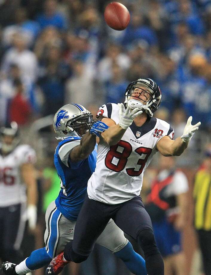 Texans wide receiver Kevin Walter (83) reaches for a pass as Lions strong safety Erik Coleman (24) defends during the fourth quarter. (Karen Warren / Houston Chronicle)