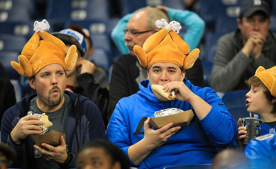 Lions fans wear turkey hats fans as they eat  before the game. (Karen Warren / Houston Chronicle)