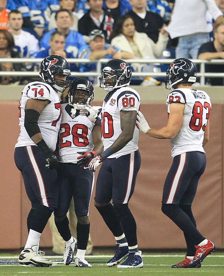 Texans running back Justin Forsett (28) celebrates his controversial touchdown with teammates . (Karen Warren / Houston Chronicle)