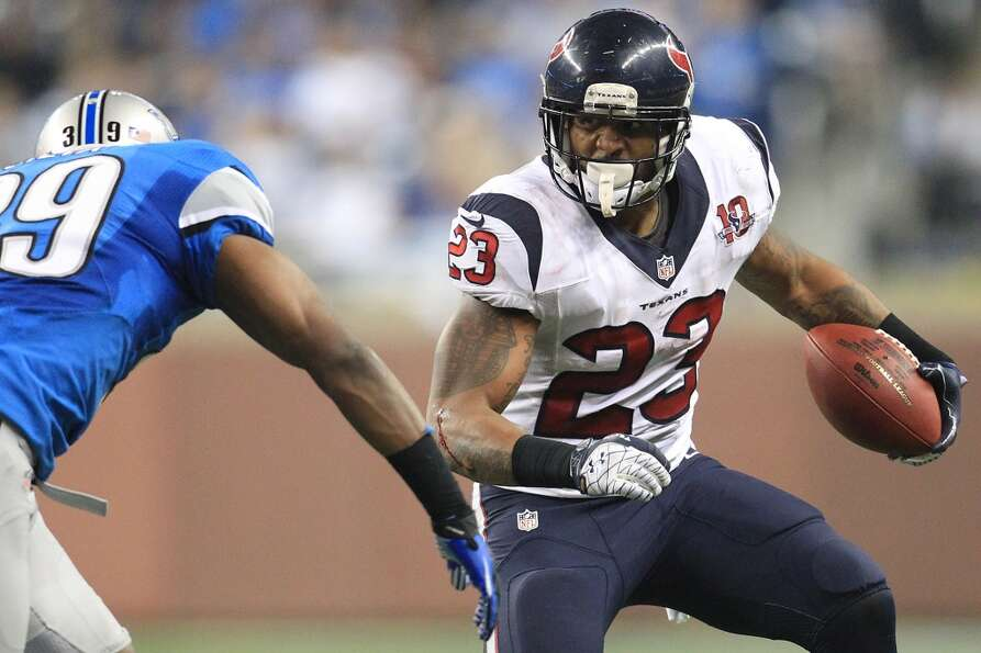 Texans running back Arian Foster (23) runs the ball against Lions free safety Ricardo Silva (39)  du