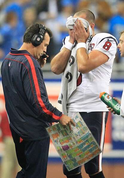 Texans quarterback Matt Schaub wipes his face during a time out. (Karen Warren / Houston Chronicle)