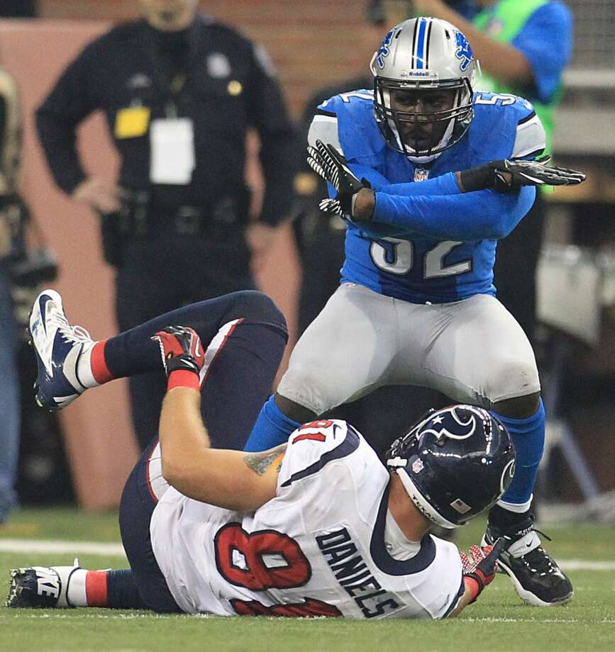 Lions outside linebacker Justin Durant (52) signals that Texans tight end Owen Daniels (81) did not catch a pass during the fourth quarter. (Karen Warren / Houston Chronicle)
