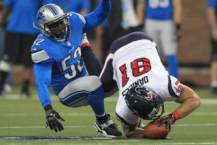 Texans tight end Owen Daniels (81) tumbles to the ground after catching a pass against Lions outside linebacker Justin Durant (52) during the first quarter. (Karen Warren / Houston Chronicle)
