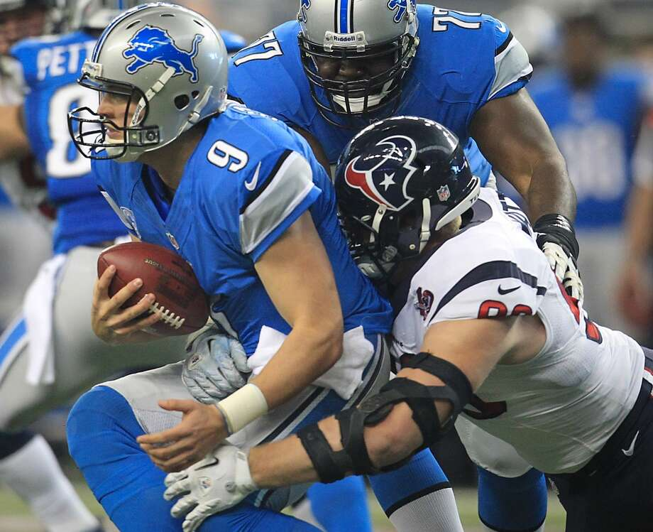 Texans defensive end J.J. Watt  sacks Detroit quarterback Matthew Stafford on the first play of the first quarter. (Karen Warren / Houston Chronicle)