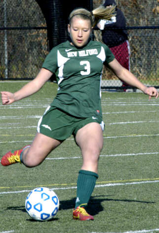 Jen Millar of the Green Wave during New Milford High School girls' soccer's state class 'LL' semifinal match vs. Newtown in Waterbury. Nov. 17, 2012 Photo: Norm Cummings