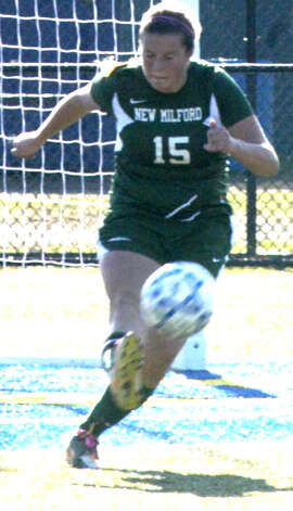Maddo Ranno of the Green Wave during New Milford High School girls' soccer's state class 'LL' semifinal match vs. Newtown in Waterbury. Nov. 17, 2012 Photo: Norm Cummings