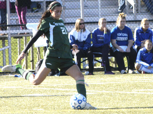 THe Green Wave's Sabrina Baxter gives Nighthawk reserves a glimpse of her technique during New Milford High School girls' soccer's state class 'LL' semifinal match vs. Newtown in Waterbury. Nov. 17, 2012 Photo: Norm Cummings