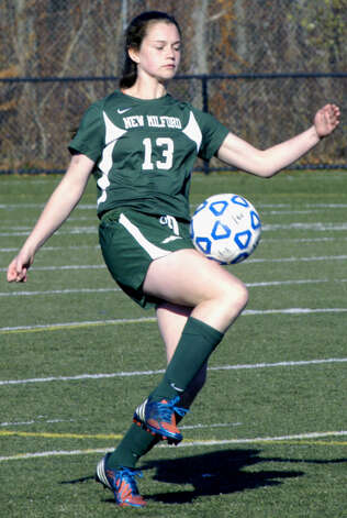 The Green Wave's Carly Drost gains possession during New Milford High School girls' soccer's state class 'LL' semifinal match vs. Newtown in Waterbury. Nov. 17, 2012 Photo: Norm Cummings