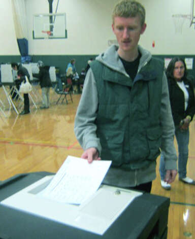 Trevor Cornelis, 22, of New Milford casts his ballot on election day, Nov. 6, 2012 at Sarah Noble Intermediate School. Photo: Norm Cummings