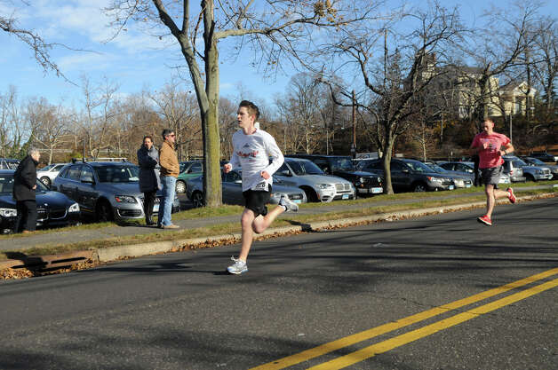 Greenwich High School runners Daniel Wilbanks and Andrew Jarombek, both 17, race to a first and second place finish in the Greenwich Alliance for Education's second Turkey Trot at Roger Sherman Baldwin Park in Greenwich, Conn., Nov. 24, 2012. Threads and Treads ran the event which raised money for Greenwich public school educational programs. Photo: Keelin Daly / Stamford Advocate Riverbend Stamford, CT