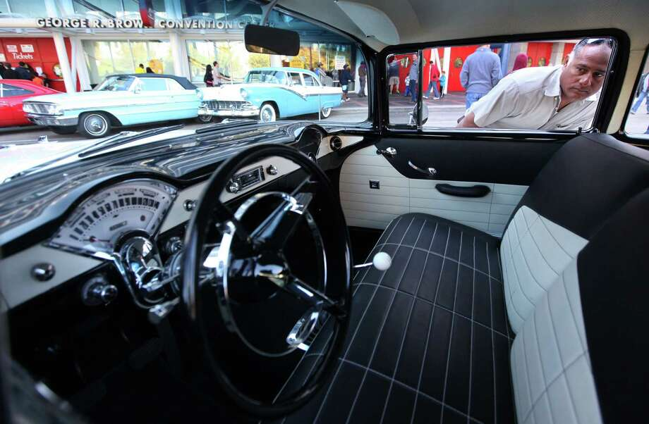 Armando Ortega views the interior of a 1957 Chevrolet. Photo: Mayra Beltran, Houston Chronicle / © 2012 Houston Chronicle