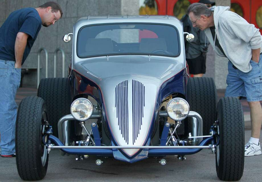 Larence Whatley and Robert Tipton view a 1937 Coupe. Photo: Mayra Beltran, Houston Chronicle / © 2012 Houston Chronicle
