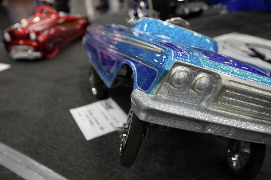 Miniature low riders are on display at AutoRama.