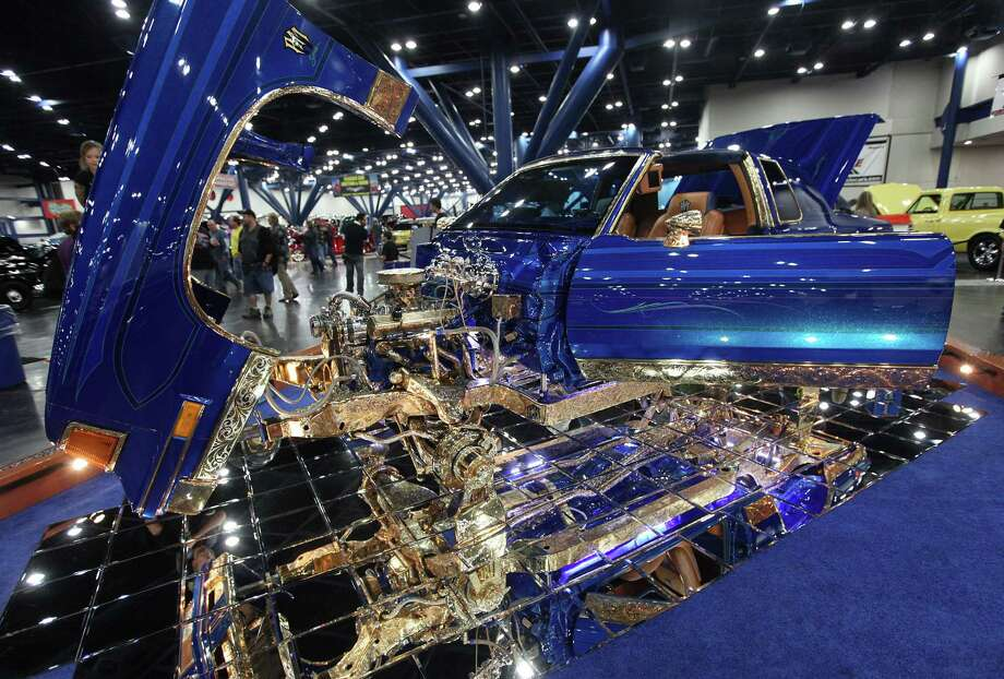 "The 1987 Oldsmobile Cutlass is a custom designed by Bobby Garza that he named ""RM Series"" is on display at the 53rd Annual AutoRama car show at George R. Brown Convention Center on Saturday, Nov. 24, 2012, in Houston.  Car show sponsored by O'Reilly Auto Parts, and continues to Sunday from 11-7 p.m. at the George R. Brown. Photo: Mayra Beltran, Houston Chronicle / © 2012 Houston Chronicle"