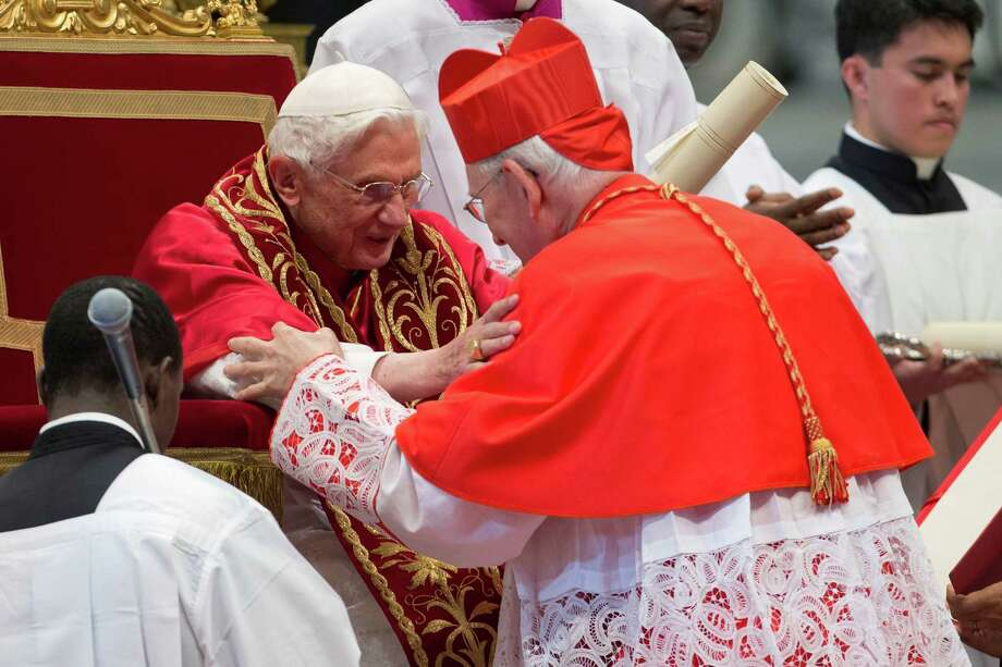 Newly elected Cardinal James Harvey, right, of the US is greeted  by Pope Benedict XVI after he received the red three-cornered biretta hat during a consistory in  St. Peter's Basilica at the Vatican, Saturday, Nov. 24, 2012. Photo: Andrew Medichini, Associated Press / AP