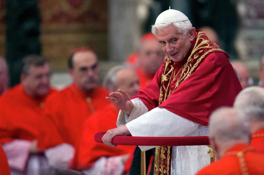 Pope Benedict XVI makes his way through cardinals as he arrives inside St. Peter's Basilica at the Vatican to preside over a consistory, Saturday, Nov. 24, 2012. Photo: Andrew Medichini, Associated Press / AP