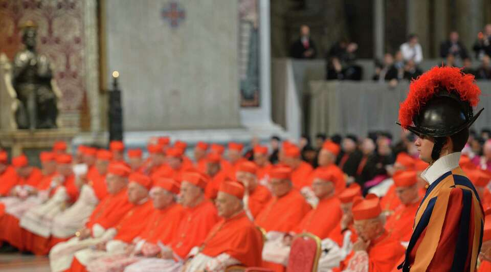 Cardinals sit during a ceremony where the pontif will appoint six new cardinals on November 24, 2012