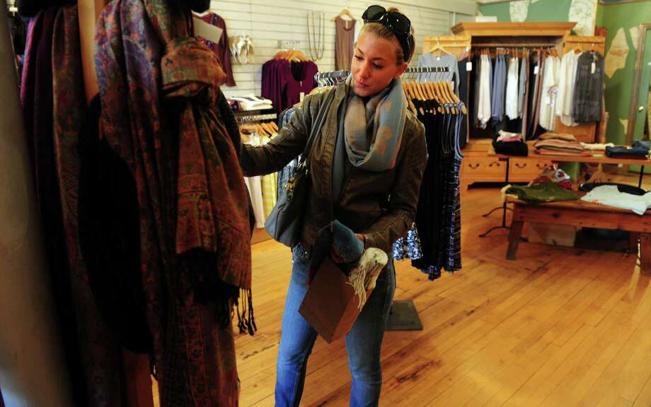 Jill Fattibene, of Fairfield, shops the Small Business Saturday sale Nov. 24, 2012 at Cargo Bay in Fairfield, Conn.  Fattibene was specifically shopping locally for the Small Business Saturday discounts, like the one at Cargo Bay where everything was 25% off. Photo: Autumn Driscoll / Connecticut Post