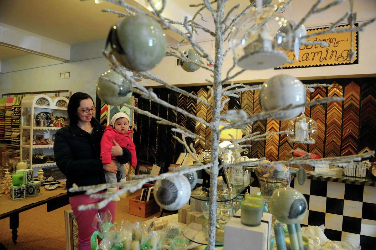 Jennifer Binkley, of Fairfield, shops locally at Palooza in Fairfield during Small Business Saturday Nov. 24, 2012 .