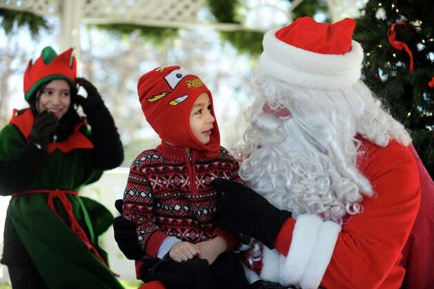 Christian Gallo, 5, of Fairfield, sits on Santa's lap during the Fairfield Chamber of Commerce's annual visit from Santa Saturday, Nov. 24, 2012 at Sherman Green in Fairfield, Conn. Photo: Autumn Driscoll / Connecticut Post