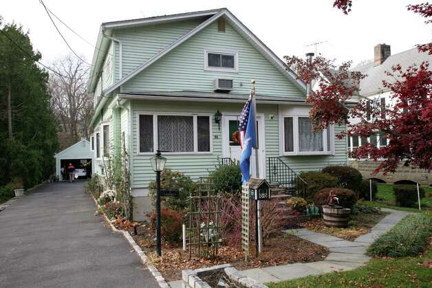 This is one of the homes on Orchard Street in Cos Cob, as seen Nov. 16, 2012, that the Greenwich Reform Synagogue is hoping to buy in order to build a new facility. Photo: DAVID AMES / GREENWICH TIME FREELANCE