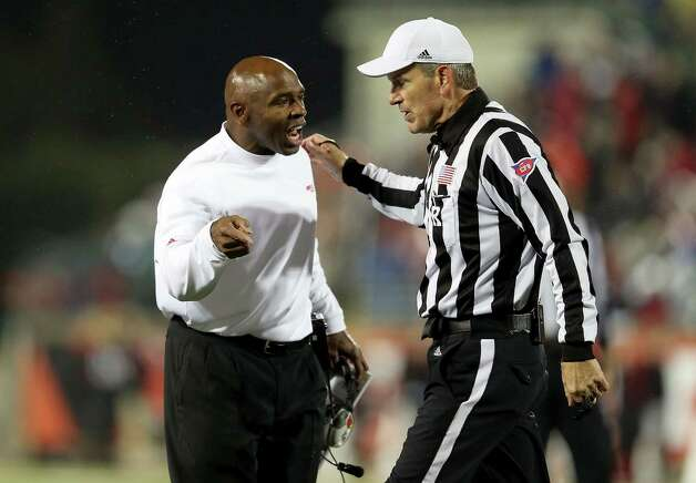 LOUISVILLE, KY - OCTOBER 26:  Charlie Strong the head coach of the Louisville Cardinals disagrees with an offical's calll during the game against the Cincinnati Bearcats at Papa John's Cardinal Stadium on October 26, 2012 in Louisville, Kentucky.  (Photo by Andy Lyons/Getty Images) Photo: Andy Lyons, Getty Images / 2012 Getty Images