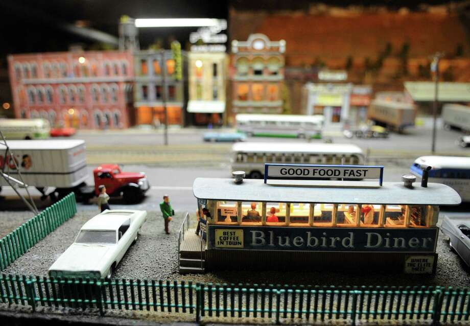 An enormous railroad scene is on display for the Stamford Model Railroad Club's 73rd annual holiday open house at St. John Episcopal's Church. The exhibit will be open to the public again on December 1 from 1-5 p.m. and 7-9 p.m. There is a five dollar entrance fee for adults, four dollars for children and children under 5 years old are admitted for free. Photo: Lindsay Niegelberg / Stamford Advocate