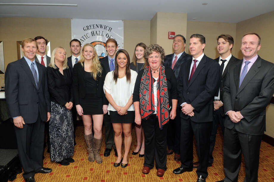 The Ninth Annual YWCA Greenwich Aquatic Hall of Fame inductees at the Greenwich Hyatt in Greenwich, Conn., Nov. 24, 2012. From left, Brad Hittle, Mark O'Connell, Kristin Norrgard, James Case, Lauren Church, Alexander Lewis, Emily Stotesbery, Rachel Sodokoff, Mary Wallace, Gary Oztemel, Anton B. Whiteford, Field Garthwaite and Kenneth A. Garnett. Photo: Keelin Daly / Stamford Advocate Riverbend Stamford, CT
