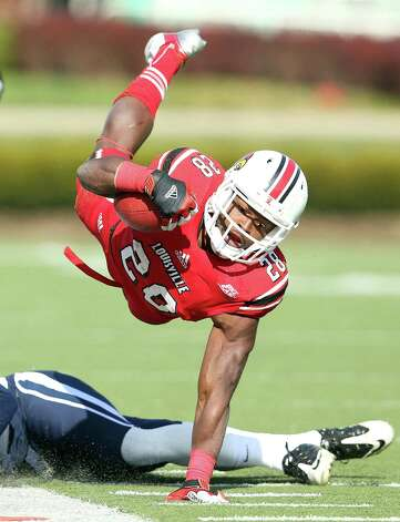 LOUISVILLE, KY - NOVEMBER 24:  Jeremy Wright #28 of the Louisville Cardinals is tripped up by Bryon Jones #16 of the Connecticut Huskies at Papa John's Cardinal Stadium on November 24, 2012 in Louisville, Kentucky.  (Photo by Andy Lyons/Getty Images) Photo: Andy Lyons, Getty Images / 2012 Getty Images