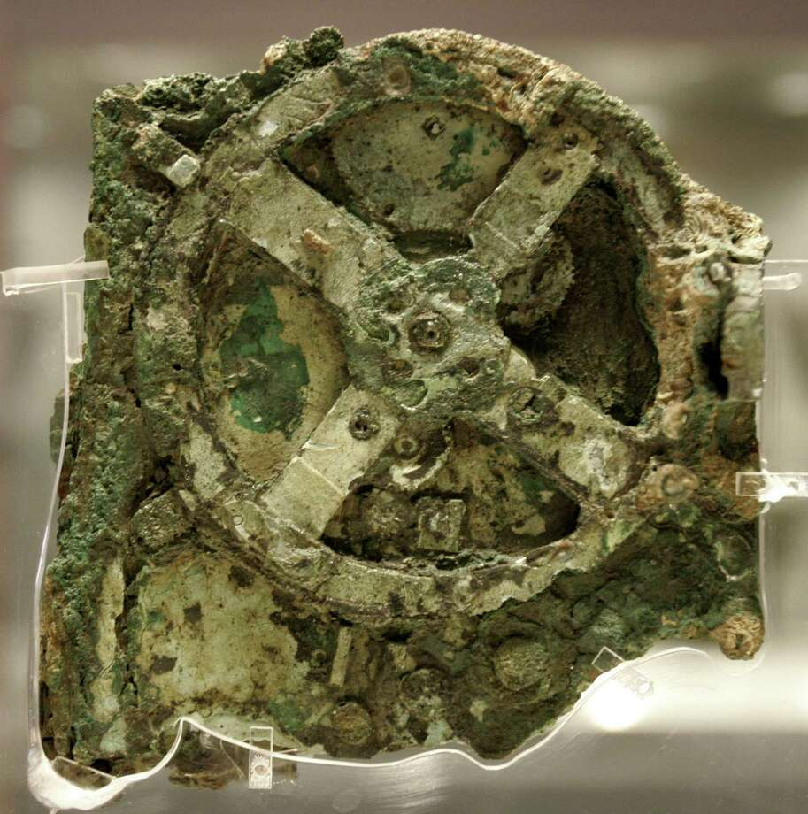 Part of the 2,100-year-old Antikythera Mechanism, found off southern Greece in 1900 and now in an Athens museum. Photo: THANASSIS STAVRAKIS, STR / AP2006
