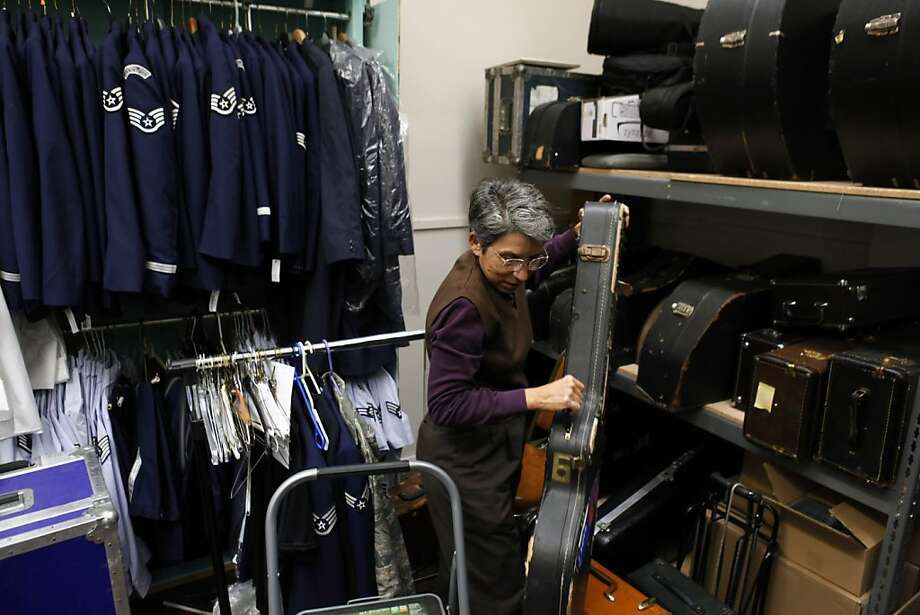 Tech. Sgt. Kim Rodriguez goes through the 561st Air Force Band's storage area at Moffett Field. Photo: Carlos Avila Gonzalez, The Chronicle
