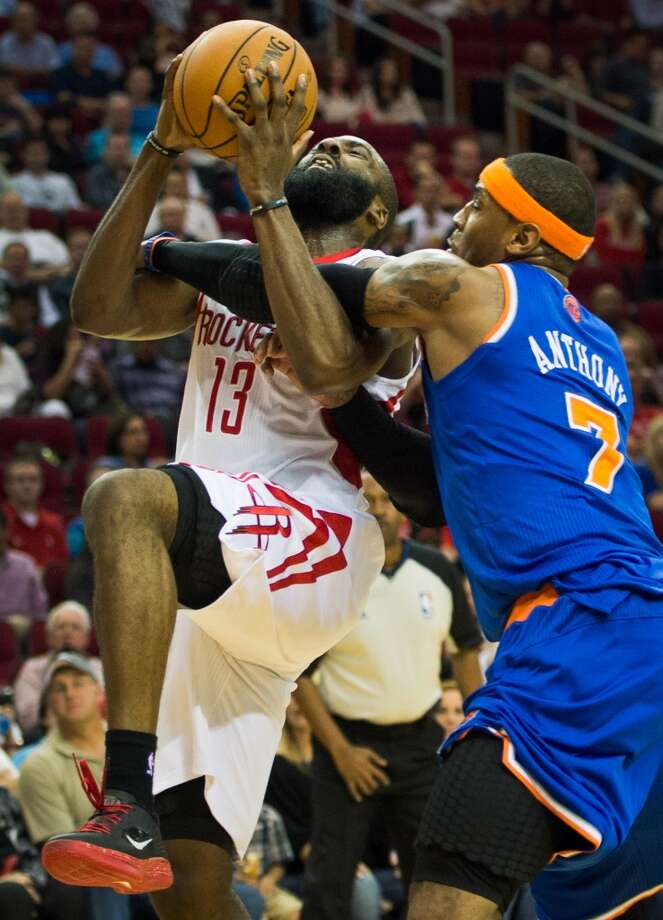 Rockets shooting guard James Harden (13) is fouled by Knicks small forward Carmelo Anthony (7) during the first half. (Smiley N. Pool / Houston Chronicle)