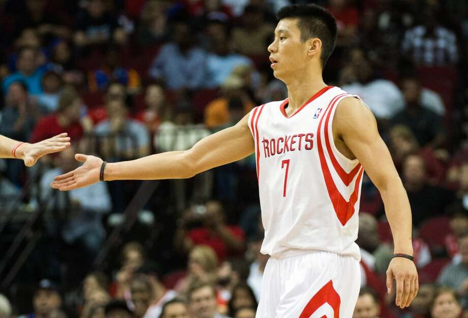 Rockets point guard Jeremy Lin (7) gets a high-five after scoring during the first half.  Lin scored 13 points in the game. (Smiley N. Pool / Houston Chronicle)