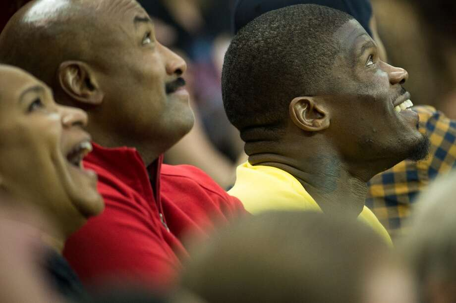 Texans wide receiver Andre Johnson watches the Rockets play the Knicks. (Smiley N. Pool / Houston Chronicle)