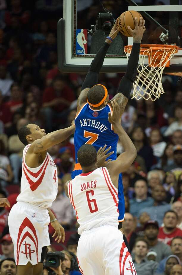 Knicks small forward Carmelo Anthony (7) drives between Rockets power forward Greg Smith (4) and power forward Terrence Jones (6) during the first half. Anthony scored 36 point in the game. (Smiley N. Pool / Houston Chronicle)