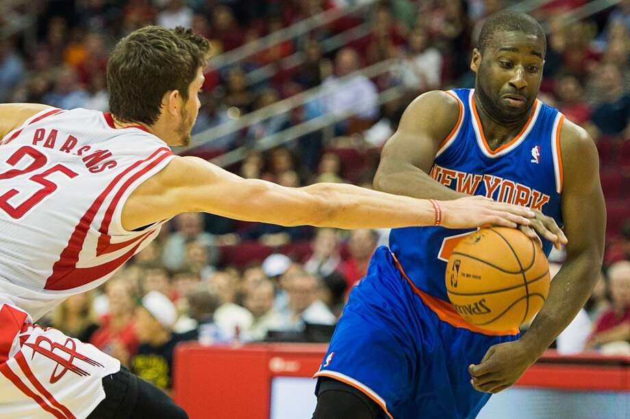 Rockets forward Chandler Parsons (25) knocks the ball away from Knicks point guard Raymond Felton (2). (Smiley N. Pool / Houston Chronicle)