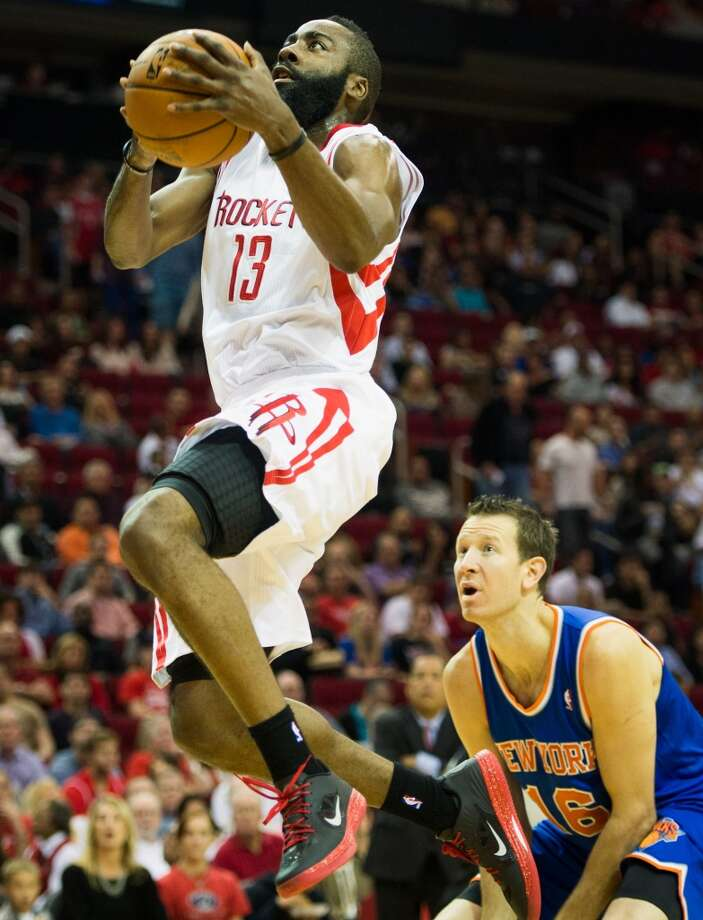 Rockets guard James Harden (13) drives to the basket past Knicks small forward Steve Novak (16). (Smiley N. Pool / Houston Chronicle)