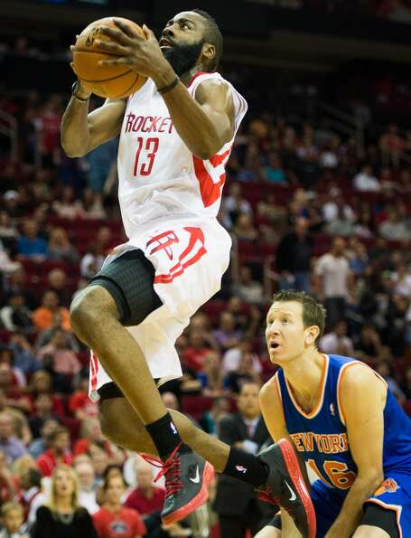 Rockets guard James Harden (13) drives to the basket past Knicks small forward Steve Novak (16). (Sm