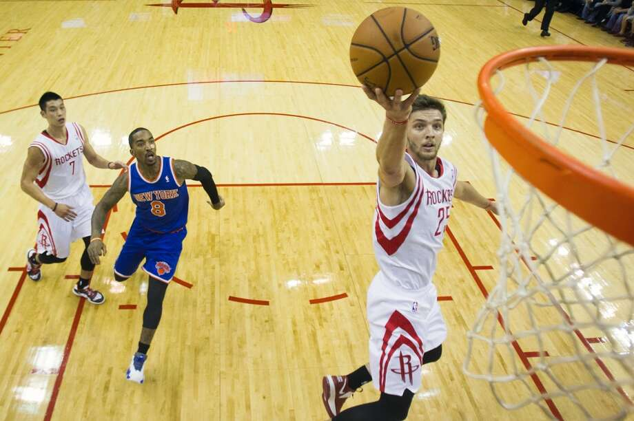 Rockets small forward Chandler Parsons (25) goes up for a layup past Knicks shooting guard J.R. Smith (8). (Smiley N. Pool / Houston Chronicle)