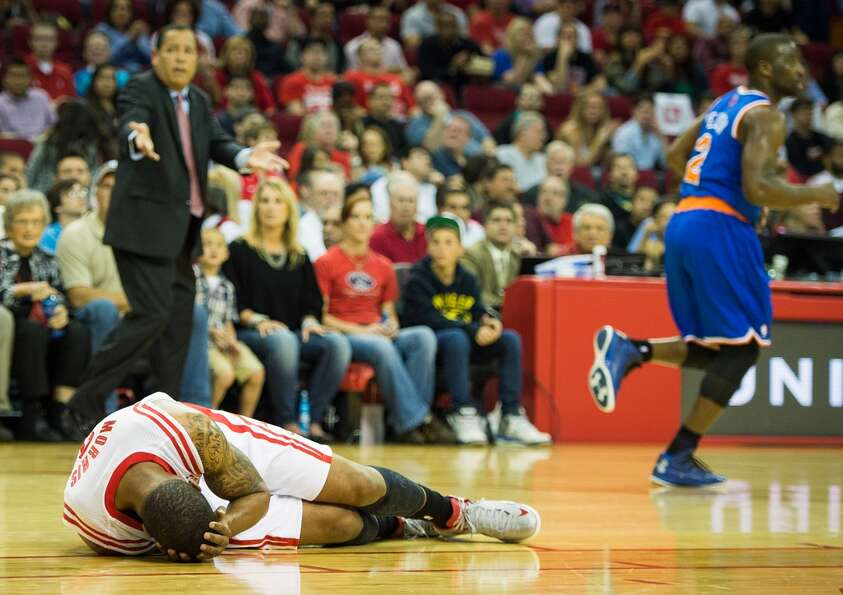 Rockets power forward Marcus Morris (2) collapses as Rockets interim head coach Kelvin Sampson looks